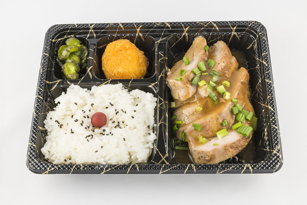 Monday - Roast Pork Bento: Slow cooked pork loin with a savory gravy. Also, topped with green onions. $6.25