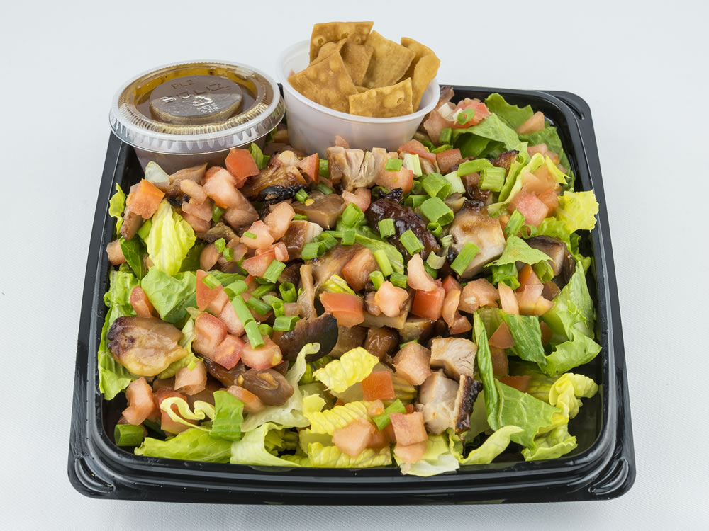 Chinese Chicken Salad: Teriyaki chicken, diced tomatoes, fried won ton, green onions, served over fresh romaine lettuce with a sesame dressing. $6.25